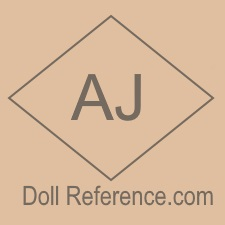 Celluloid doll mark AJ inside a diamond
